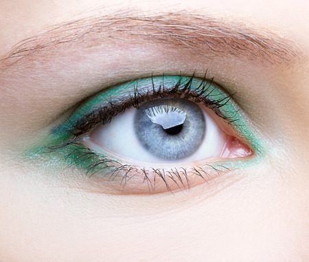 blue eye: Close-up shot of female face with eye makeup Stock Photo