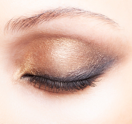 smoky eyes: Close-up shot of female closed eye make-up in smoky eyes style