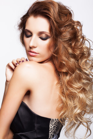 hairy arms: Portrait of young beautiful woman with curly shaggy hair style with smoky eyes make-up on gray background