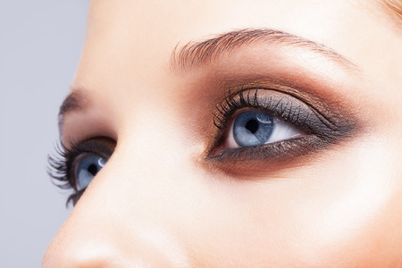 makeup eyes: Close-up shot of female eyes make-up in smoky eyes style