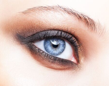 eye close up: Close-up shot of female eye make-up in smoky eyes style Stock Photo
