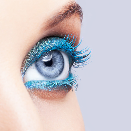 Close-up shot of female eye blue color make-up Standard-Bild
