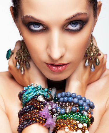 blue hair: Portrait of young pretty woman with bijouterie on hands looking in camera