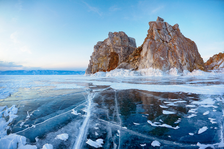 frozen lake: Mount Shamanka or Cape Burkhan on siberian lake Baikal at winter