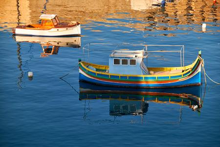 armlet: National maltese bout luzzu in malta bay between Birgu and Kalkara at morning time