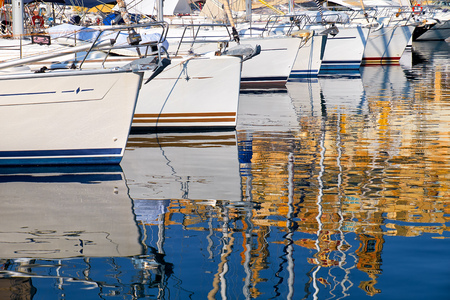 waterline: Reflection of yachts and maltese architecture in water of malta bay