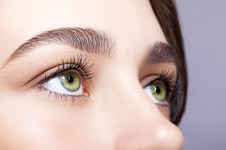 Closeup shot of female green pistachio colour eye  with day makeup