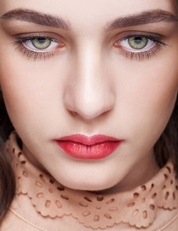 Closeup shot of female face with day makeup and  green pistachio colour eyes Standard-Bild