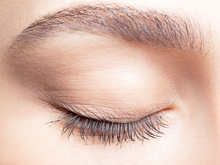 closed up: Closeup shot of female closed eye and brows with day makeup