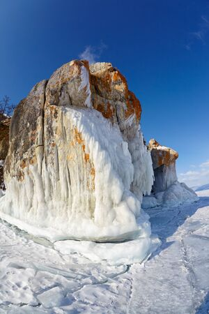 baical: Rocks covered by lichens on winter siberian Baikail lake
