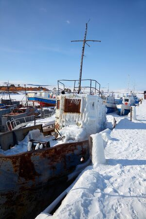 baical: Old frozen ships in the port of Olkhon island on siberian lake Baikal at winter time