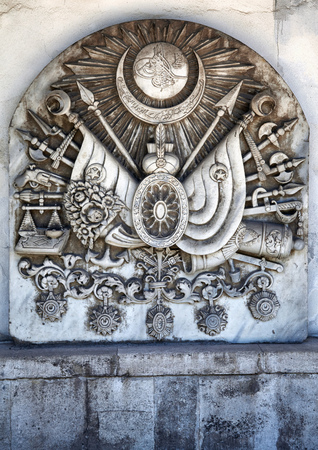 ottoman empire: ISTANBUL, TURKEY - JULY 12, 2014: Coat of arms of the Ottoman Empire bas-relief on the wall on the territory of Topkapi Palace, Istanbul, Turkey