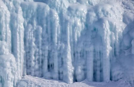 hollow walls: Icicles background on the ice wall on Baikal lake at winter
