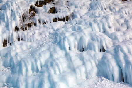 hollow walls: Ice over rocks wall on Baikal lake at winter time Stock Photo