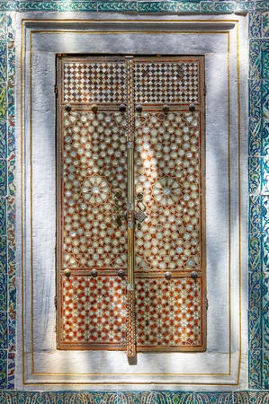 inlaid: ISTANBUL, TURKEY - JULY 12, 2014: An inlaid mother-of-pearl doors in sunlight  in Topkapi palace Harem Hall with a Fountain, Istanbul , Turkey