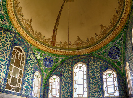 ligature: ISTANBUL, TURKEY - JULY 12, 2014: The interior decoration with some Islamic elements blue tiles,  oriental ornaments and Arabic ligature in Harem of Topkapi Palace, Istanbul, Turkey Editorial