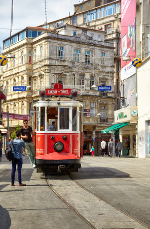 croud: ISTANBUL, TURKEY - JULY 13, 2014:  Heritage trams of a Taksim-Tunel Nostalgia Tramway line operates on Istiklal Street between Taksim Square and underground railway line - Tunnel.  Istanbul, Turkey Editorial