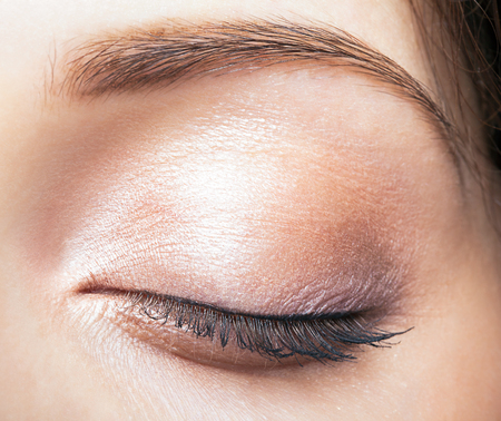eye brow: Closeup shot of female closed eye and brows with day makeup