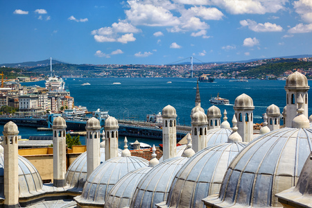 suleymaniye: The view of the Bosphorus with the Bosphorus bridge from the courtyard of Suleymaniye Mosque throught the domes of third and fourth madrasas, Istanbul, Turkey Editorial
