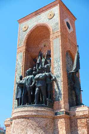 founders: ISTANBUL, TURKEY - JULY 13, 2014: Monument of Republic on Taksim Square commemorate the formation of the Turkish Republic. It portrays the founders of Turkish Republic: Kemal Ataturk and his comrades