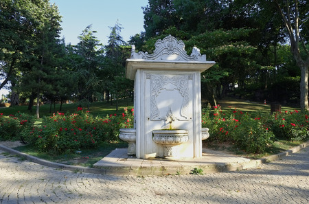 fountain: The ottoman style fountain and the rose garden in the Gulhane Park. Gulhane Park Rosehouse Park is a historical urban park in the Eminonu district next to the Topkapi Palace in Istanbul. Turkey.