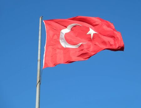 flagging: Turkish flag waving in the blue sky, Istanbul, Turkey Stock Photo
