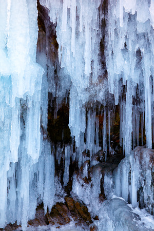 hollow wall: Icicles background on the ice wall on Baikal lake at winter