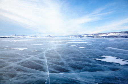 frozen lake: Winter ice landscape on Siberian lake Baikal with dramatic weather clouds front before the Storm