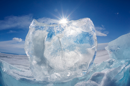 arctic landscape: Ice floe and sun over winter Baikal lake Stock Photo