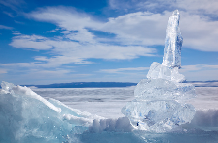 floe: Ice floe crystal under blue sky over winter Baikal lake