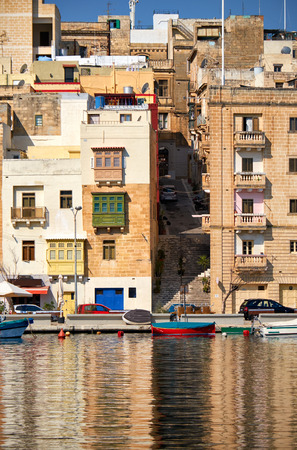 residential houses: The view of Senglea residential houses over the Dahla tad-Dockyard bay. Malta. Stock Photo