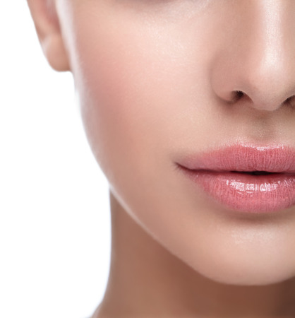 Half face female beauty portrait with healthy skin and Rose Quartz color lips Stock Photo - 50255321