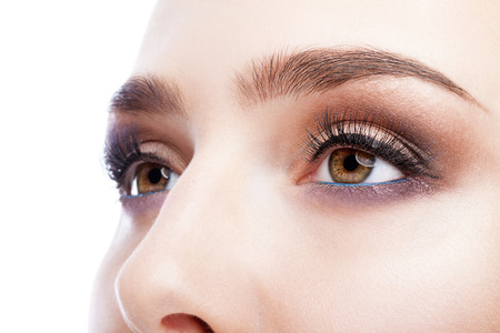 Closeup shot of female eye with day makeup in aqua Limpet Shell color eye shadows and Snorkel Blue colour liner