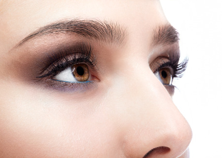 Closeup shot of female eye  with day makeup in aqua Limpet Shell color eye shadows and Snorkel Blue colour liner Stock Photo