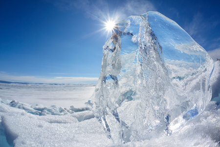 polar climate: Ice floe crystal and sun over winter Baikal lake Stock Photo