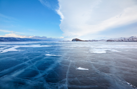 baical: Winter ice landscape on Siberian lake Baikal with dramatic weather clouds front before the Storm