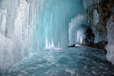 Ice cave on Olkhon island on Baikal lake in Siberia at winter time 免版税图像