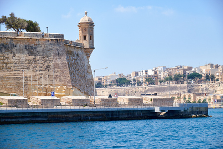 The view from the water of the end of Senglea L-isla peninsula with the Guard tower on the tip of the bastions. Malta.