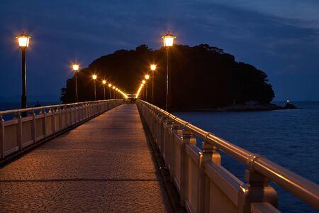 pavement: Night view on bridge from Take Island to Gamagori, Aichi prefecture, Japan Stock Photo