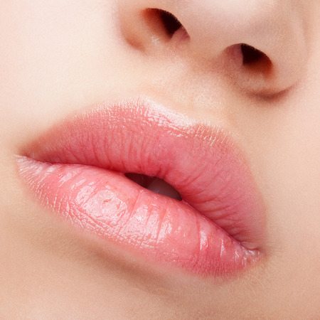 Close-up beauty shot of female full lips with healthy skin and rose color lips Фото со стока - 53681312