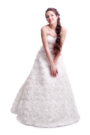 decollete: Portrait of beautiful young brunette woman bride in white Wedding Dress on light gray background