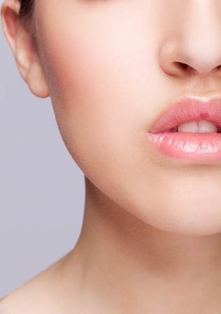 skin color: Half face female beauty portrait with healthy skin and rose color lips