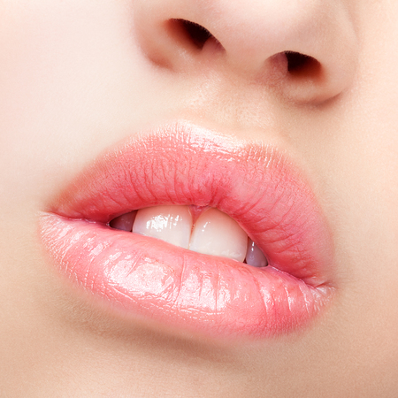 full lips: Close-up beauty shot of female full lips with healthy skin and rose color lips