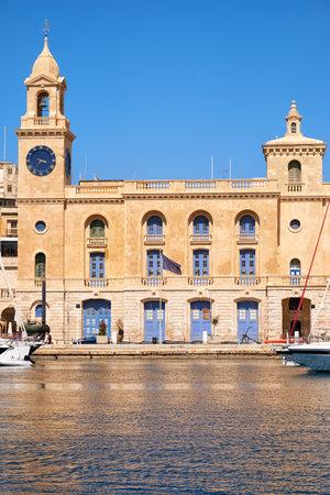 dockyard: The view of  the clock tower of Malta Maritime Museum over the water of Dockyard creek. Birgu, Malta Editorial
