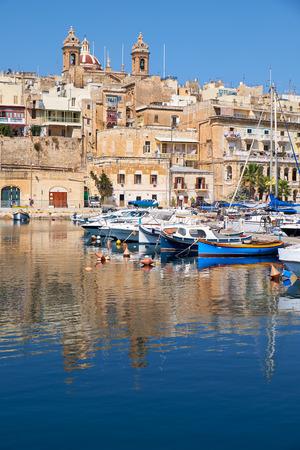 dockyard: The view of historical buildings of old capital Vittoriosa over the Dockyard creek. Malta. Stock Photo