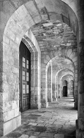 colonnaded: Kalkara, MALTA - JULY 24, 2015: Black and white image of portico roofed colonnaded terrace of the Malta Maritime Museum (Old Naval bakery) in Vittoriosa (Birgu). Malta. Editorial