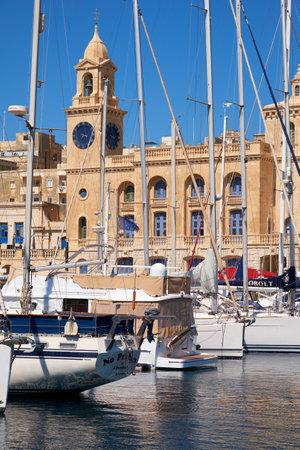 dockyard: Birgu, MALTA - JULY 24, 2015: The yachts and boats moored in the harbor in Dockyard creek in front of Malta Maritime Museum. Malta.