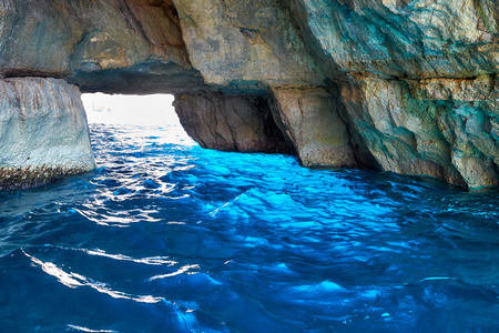 Inside Blue Grotto - nature landmark on south part of Malta island Фото со стока - 55841681
