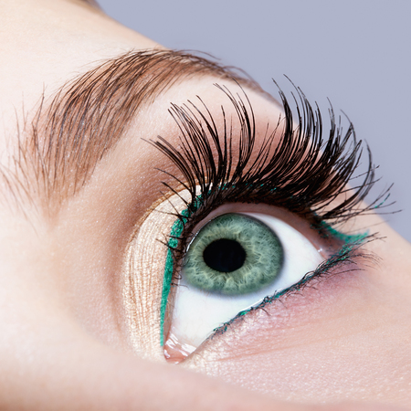 face shot: Closeup shot of female face makeup with pistachio colour eye  and green eyeliner