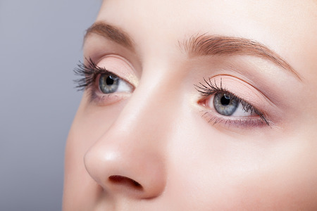 Closeup shot of female blue colour eyes  with day makeup